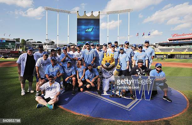 The White and Blue teams pose for pictures after the Star Spangled Softball game at Kauffman Stadium during the 2016 Big Slick Celebrity Weekend on...