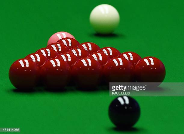 The white ball is played down the table towards the reds during the quarter final match between Shaun Murphy of England and Anthony McGill of...