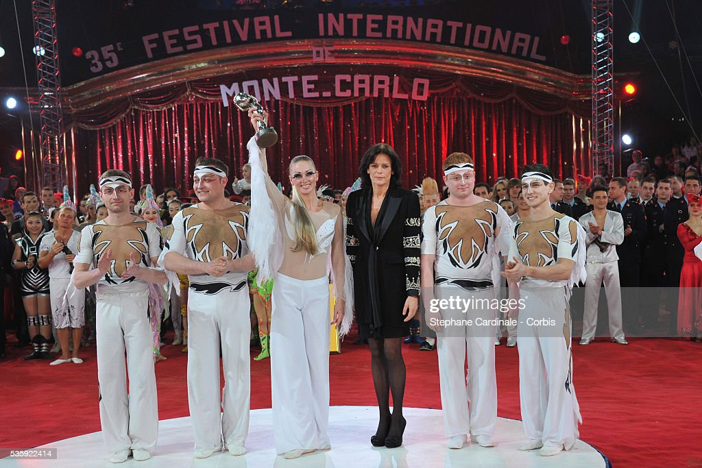 The White Birds performers receive the 'Silver Clown' award from Princess Stephanie (C) during the official Award Gala evening of the 35th Monte Carlo International Circus Festival.