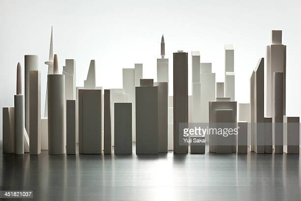 the white buildings  made of paper in line