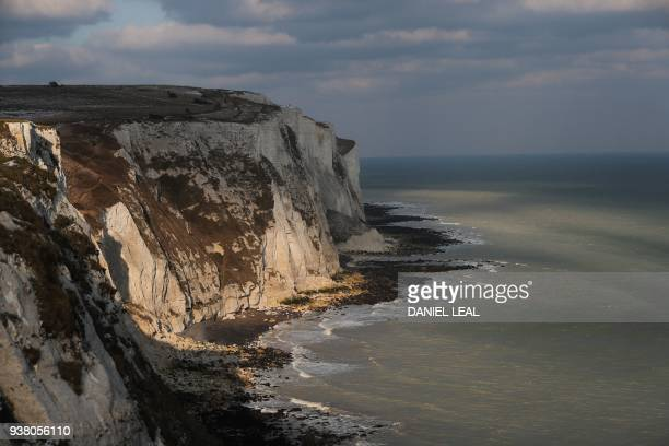The White Cliffs of Dover are seen on the south coast of England on March 19 2018 Despite being the UK's gateway to Europe locals in Dover on...