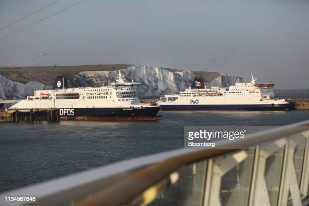 The white cliffs of Dover sit beyond the cross-Channel ferries Delft Seaways, left, operated by DFDS A/S, and Pride of Burgundy, operated by P&O...