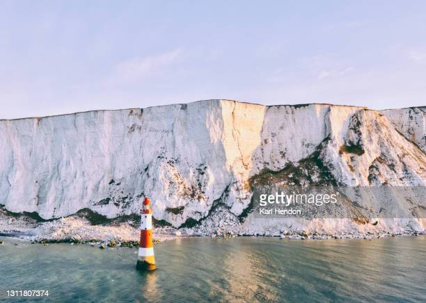 the white cliffs of east sussex and beachy head lighthouse - stock photo - tourism stock pictures, royalty-free photos & images