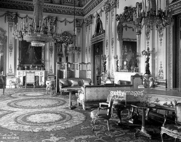 The White Drawing Room inside Buckingham Palace, showing its ornate design in white and gold. In the room can be seen some fine specimens of French...