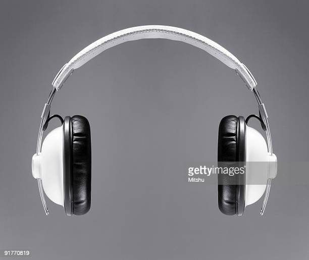 the white headphones - headphones stock pictures, royalty-free photos & images