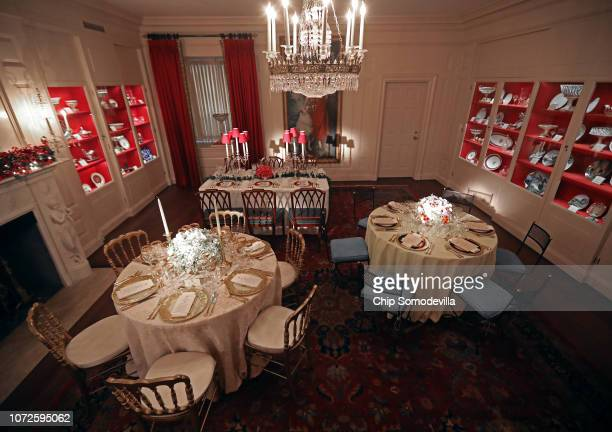 The White House China Room is decorated for the holidays with three replicas from previous state dinners from the administrations of Theodore...