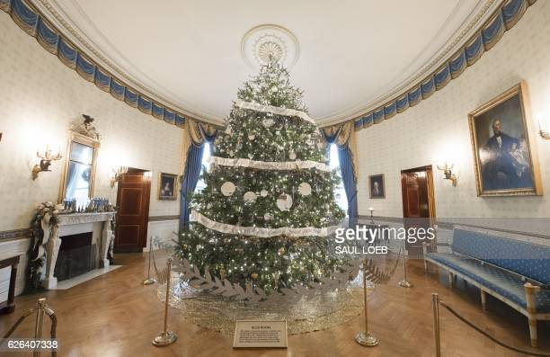 The White House Christmas Tree in the Blue Room of the White House in Washington DC November 29 2016 / AFP / SAUL LOEB