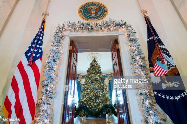 The White House Christmas Tree is seen in the Blue Room during a preview of holiday decorations at the White House in Washington DC November 27 2017...