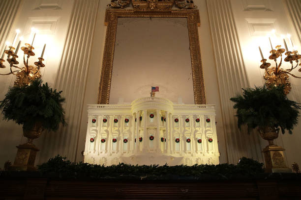 the white house gingerbread house is on display in the state dining room at the white