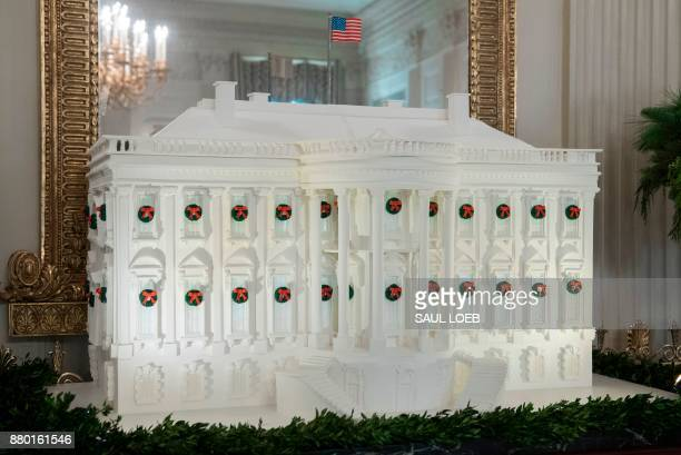 The White House Gingerbread House is seen in the State Dining Room during a preview of Christmas and holiday decorations at the White House in...