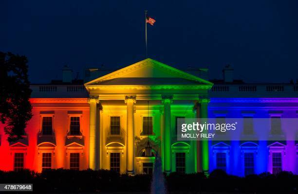 The White House is blanketed in rainbow colors symbolizing LGBT pride in Washington on June 26, 2015. The US Supreme Court ruled Friday that gay...