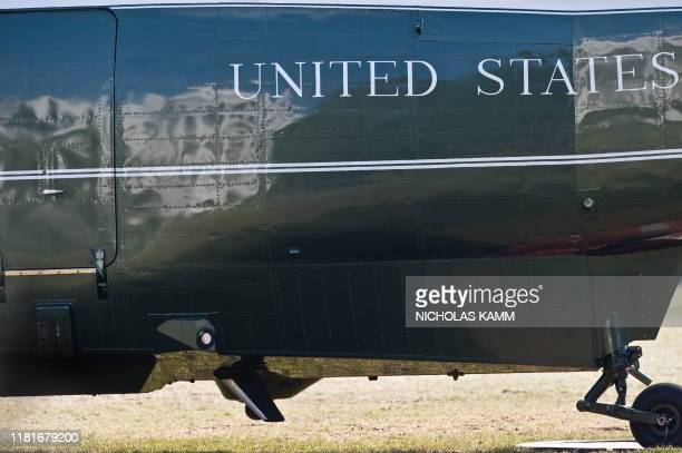 The White House is reflected on the side of Marine One after it landed as US President Barack Obama returned to the White House in WashingtonDC on...