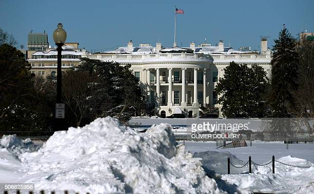 The White House is seen covered by snow on January 24 2016 in Washington Millions of people in the eastern United States started digging out Sunday...