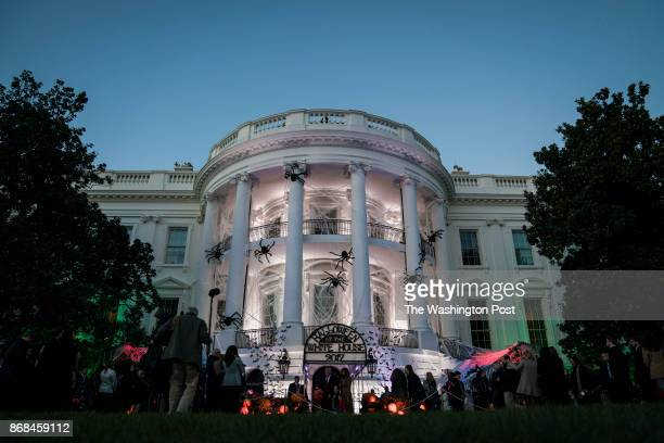 The White House is seen covered in decorations as President Donald Trump and first lady Melania Trump hand out treats as they welcome children from...