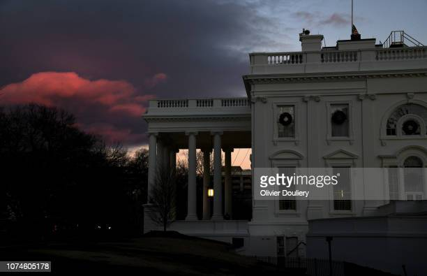 The White House is seen from the North portico on December 22 2018 in Washington DC The government partially shutdown at midnight after congress...