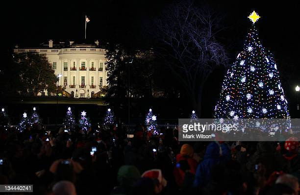 The White House is seen in the background after the National Christmas Tree was lit during its lighting ceremony on December 1 2011 at the Ellipse...