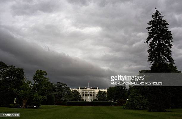 The White House is seen under dark rain clouds in Washington DC on June 1 2015 The national weather forecast calls for severe weather for much of the...