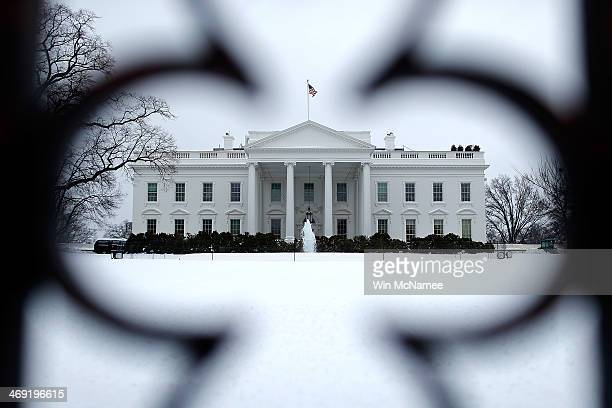 The White House north lawn is covered in snow February 13, 2014 in Washington, DC. The east coast of the U.S. Was hit with a winter storm leaving up...