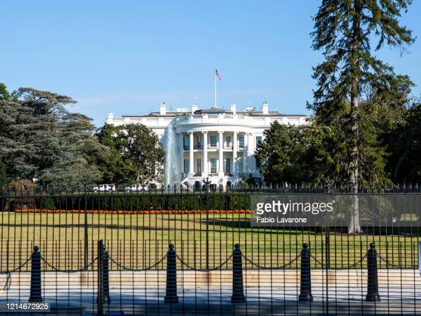 white house seen from over fence
