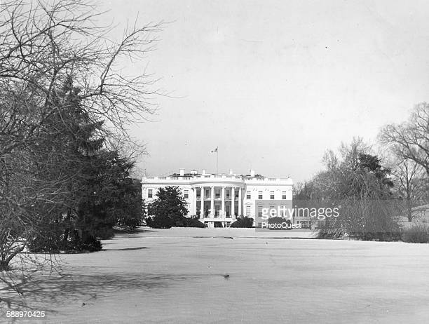 The White House seen from the snowcovered south lawn in the winter Washington DC 1948
