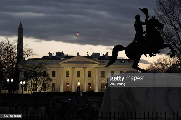 The White House sits across from Lafayette Square at dusk January 8 2019 in Washington DC US President Donald Trump is scheduled to give his first...