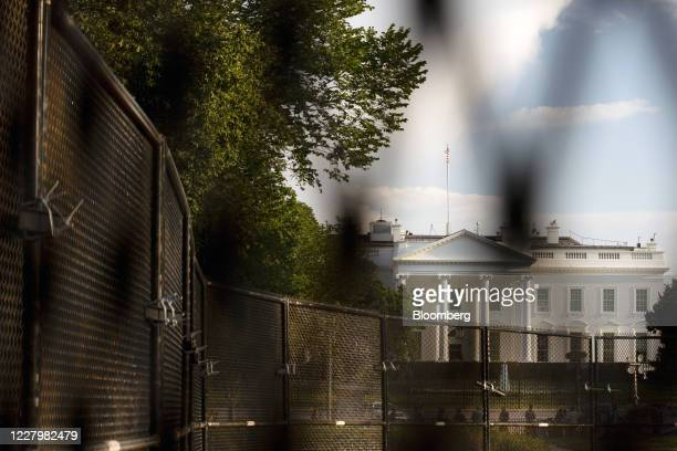 The White House stands behind fencing in Washington, D.C., U.S. On Sunday, Aug. 9, 2020. Trump announced four executive actions on Saturday,...