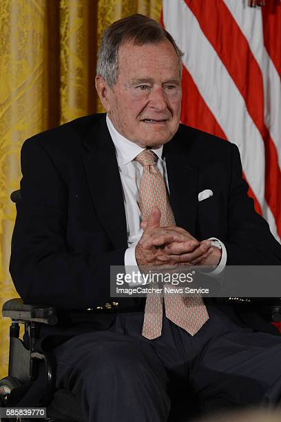 7/15/13 The White House Washington DC President Barack Obama honors former President George H W Bush as they present the 5000th Daily Point of Light...