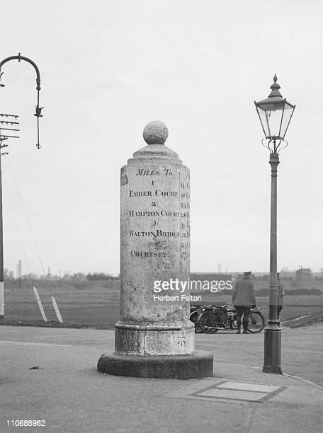 The White Lady a milestone outside the Orleans Arms Esher Surrey circa 1946