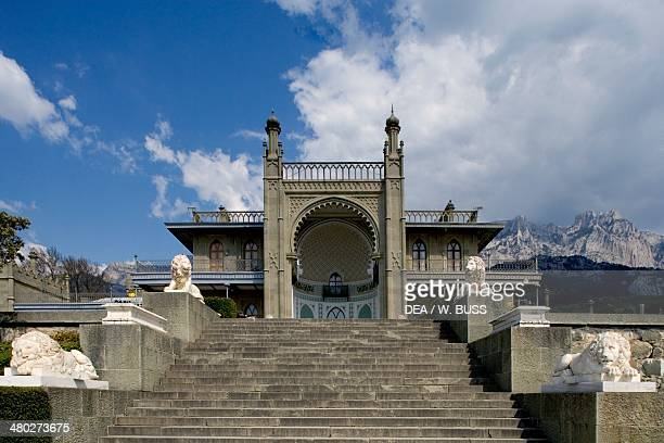 The white marble staircase and lions from the neoMoorish style southern facade of Vorontsov Palace 18281846 designed by Edward Blore with the AyPetri...
