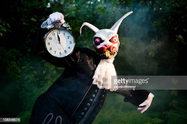the white rabbit - evil stock photos and pictures