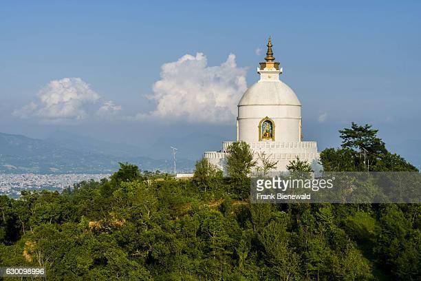 The white Shanti Stupa is located on a hill above Phewa Lake