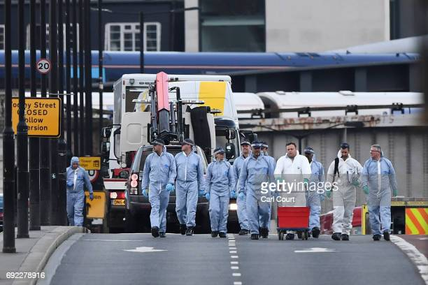 The white van used in the attack is loaded onto a truck on London Bridge on June 4 2017 in London England Police are investigationg last night's...