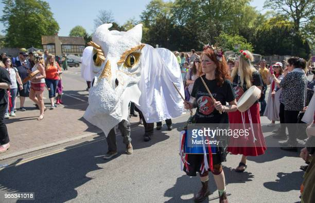 The white winter dragon one of the two Glastonbury Dragons is paraded through the town as they take part in May Fayre and Dragon Procession in...