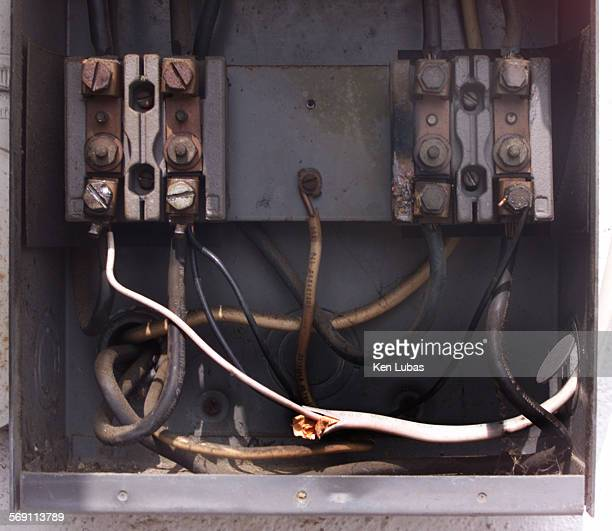 The white wire is the illegal electric tap bypassing meter at a Los Church Burned circuitry points out the dangers of such acts according to John...
