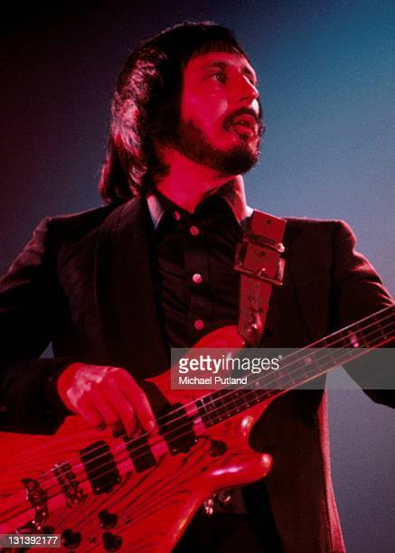 The Who perform on stage Wembley Empire Pool London October 1975 John Entwistle He plays an Alembic Series I bass guitar