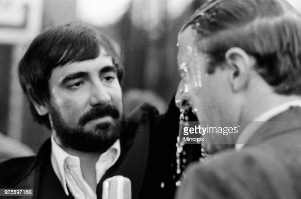 The Who rock group in concert at The Valley, home ground of Charlton Athletic Football Club. Drummer Keith Moon pours vodka over the head of...