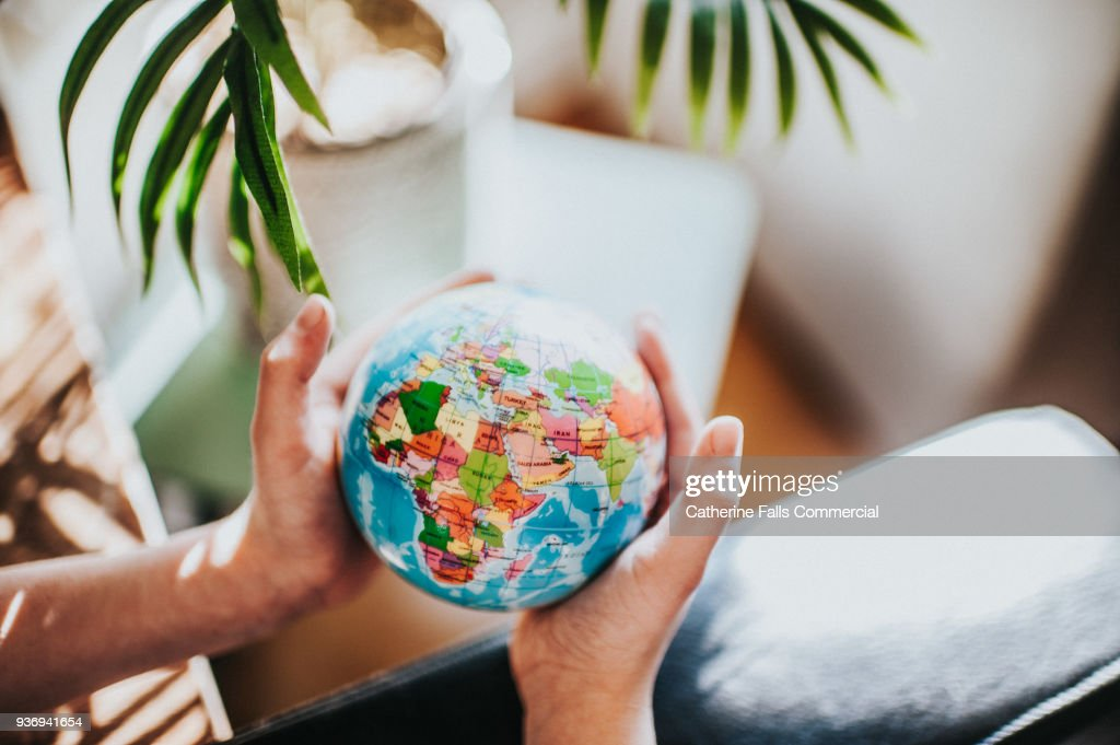 The Whole World in His Hands : Stock Photo