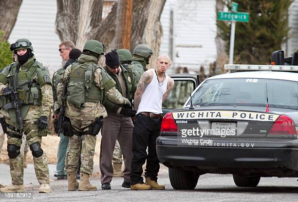 The Wichita Police SWAT team converge on a house in the 2400 block of Newell near Meridian and Central Wednesday January 9 during a standoff and took...