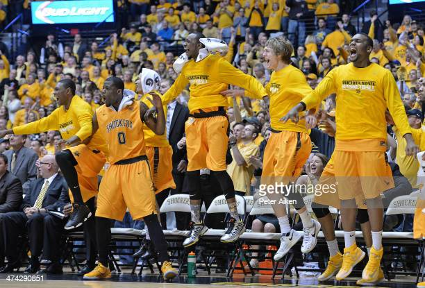 The Wichita State Shockers bench celebrates after defeating the Drake Bulldogs to win the Missouri Valley Conference on February 22 2014 at Charles...