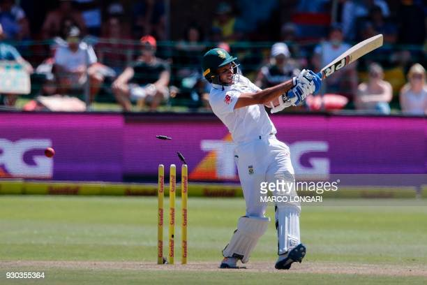 TOPSHOT The wicket of South Africa's batsman Keshav Maharaj is taken by Australia bowler Josh Hazlewood during day three of the second Test cricket...