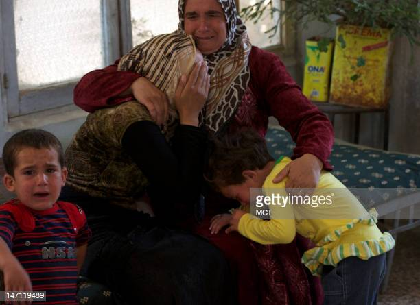 The widow children and motherinlaw of a slain rebel fighter mourn at his funeral June 23 2012 in Bweda Sharkiya Syria