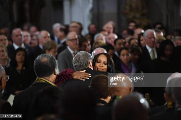 The widow of Congressman Elijah Cummings Maya Rockeymoore Cummings is embraced by Congressman Mark Meadows during a memorial service for Cummings in...