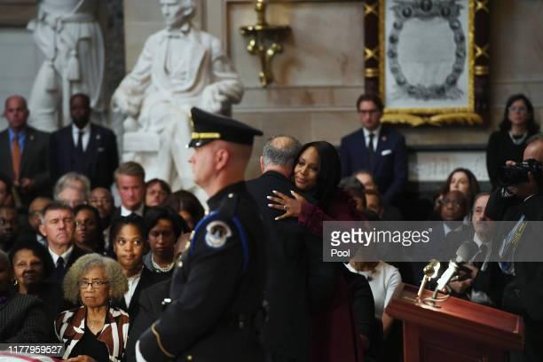The widow of Congressman Elijah Cummings Maya Rockeymoore Cummings is embraced by Senate Minority Leader Chuck Schumer during a memorial service for...