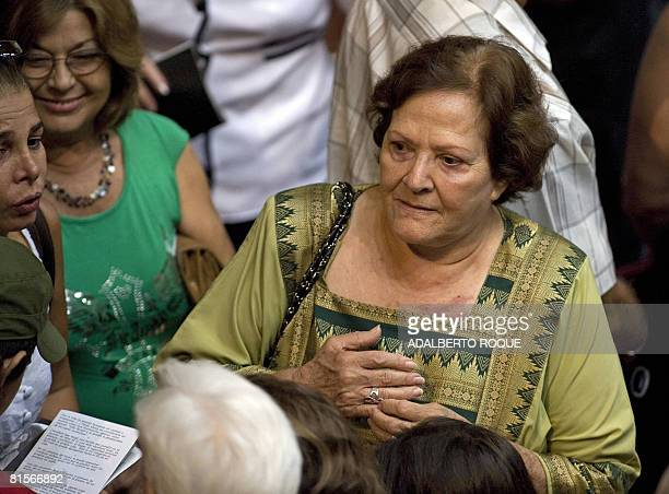 The widow of Ernesto 'Che' Guevara Aleida Guevara March talks with friends at the Karl Marx theatre in Havana on June 13 2008 during a cultural gala...