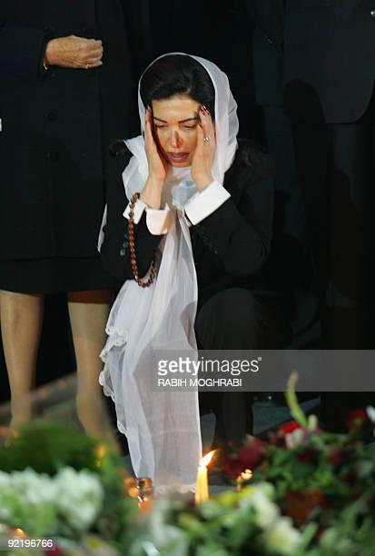 The widow of Lebanon's slain former prime minister Rafiq Hariri Nazek grieves over his grave in central Beirut 16 February 2005 Hariri's funeral...
