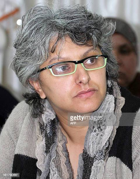 The widow of murdered opposition figure Chokri Belaid Besma Khalfaoui listens during a meeting with representatives of the Tunisia's leftist...