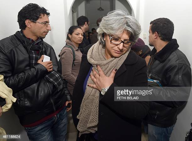 The widow of murdered Tunisian opposition figure Chokri Belaid Basma Khalfaoui arrives at the headquarters of the National Union of Tunisian...