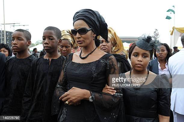 The widow of Nigeria's seccessionist leader Odumegwu Ojukwu Bianca Ojukwu and her children arrive to attend the national interdenominational funeral...