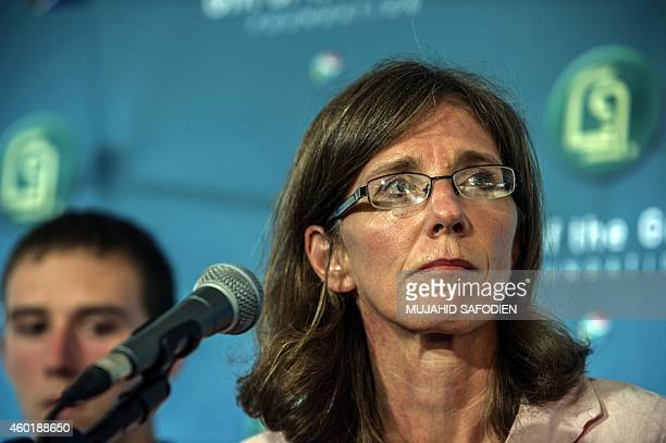 The widow of slain South African hostage Pierre Korkie Yolanda Korkie reacts as she gives a press conference on December 9 2014 at the Gift of the...