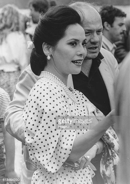 The widow of the indonesian prime minister Sukarno Ratna Sari Dewi Sukarno with Udo Proksch at the Formula 1 race in Zeltweg Styria 19th August 1984...